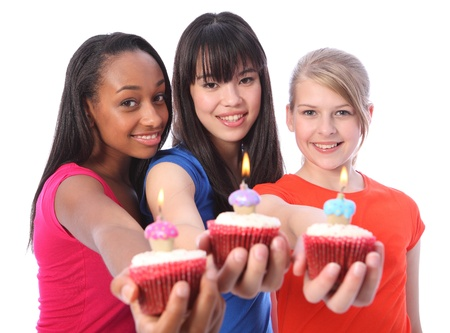 Birthday celebration with cakes for three beautiful young teenager girl friends a blonde caucasian, an oriental Japanese and an African American all with happy smiles. Stock Photo - 11025265