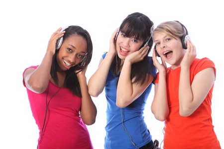 sing: Three beautiful young teenager girl friends a blonde caucasian, an oriental Japanese and an African American girl having fun singing to cell phone music on headphones.