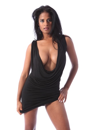 Big boobs and voluptuous cleavage of beautiful african american glamour model striking sexy pose wearing short black dress and stiletto heels. Stock Photo - 11148855