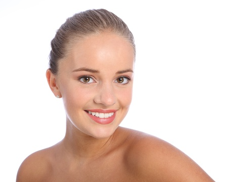 Beautiful happy smiling headshot of cheerful young caucasian teenager girl with brown eyes, taken against white background. photo