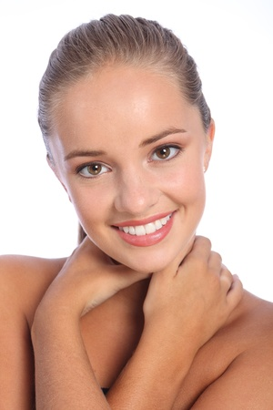 perfect face: Dazzling happy smiling headshot of cheerful young caucasian teenager girl with beautiful brown eyes, taken against white background.
