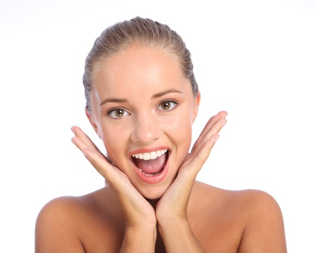 teen girl brown hair: Happy surprise for beautiful young teenager girl with lovely big smile and brown eyes, showing delight and excitement with both hands raised. Stock Photo