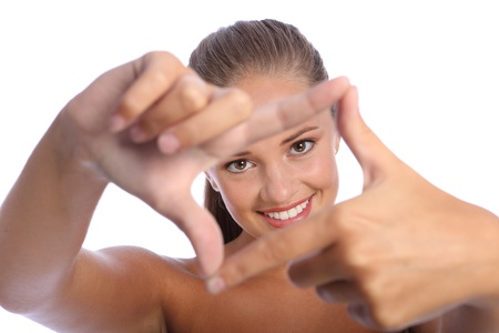 Fun frame hand sign by a beautiful happy young teenager girl with big cheerful smile and brown eyes. photo