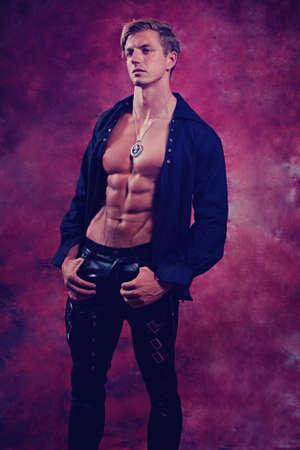 Sexy male vampire against a crimson Imagens