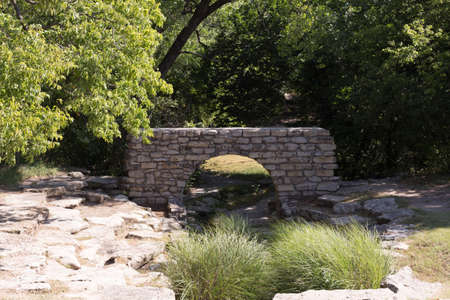 outoors: Stone arch over a brook