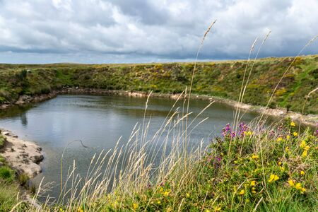Crazywell Pool created by tin miner excavations near Princetown, Dartmoor, Devon
