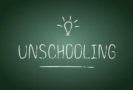 free education: Unschooling lettering in vector. Chalk board and chalk effect. Free education and study at home. Illustration