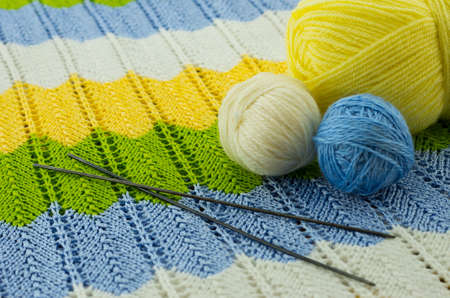 ravel: the skeins of colorful thread and the needles Stock Photo