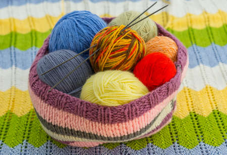 the skeins of colorful thread and the needles Stock Photo