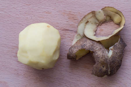ooking: The raw peeled potato on the cutting board