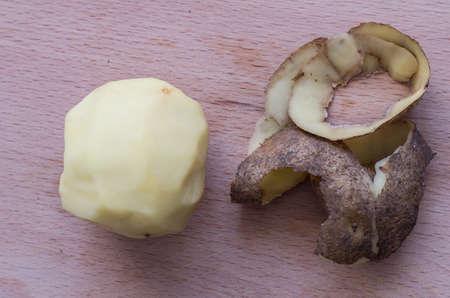 ooking: The raw peeled potato on the cutting board