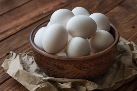 chiken: The chiken eggs on the wooden table