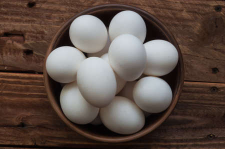 The chiken eggs on the wooden table