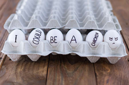 terminated: The cardboard egg tray with chicken eggs. Social concept. Pro-life. Angle view.