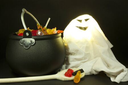 pot with candy near a ghost