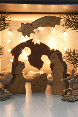 handmade wooden crib with lights in the background