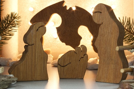 handmade wooden crib with lights in the background photo