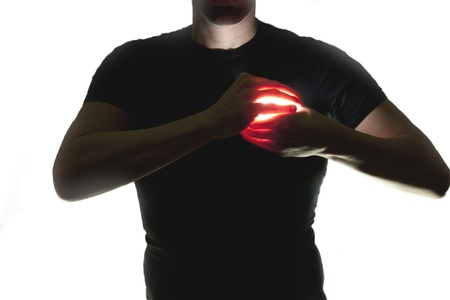 silhouette of man holding a luminous heart