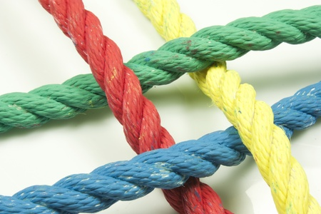 synergy: intertwining of four strings of different colors Stock Photo