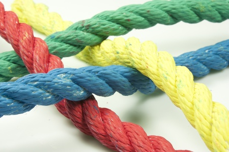 cordage: intertwining of four strings of different colors Stock Photo