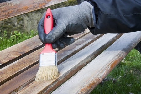 man while painting a bench Stock Photo