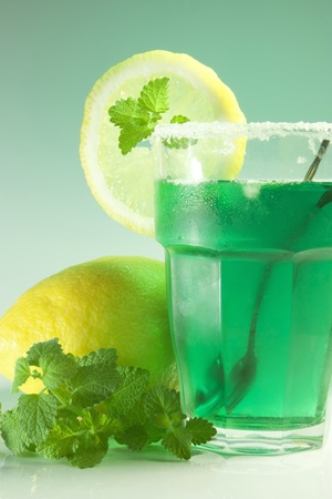 edge of the ice: glass of water with lemon and mint