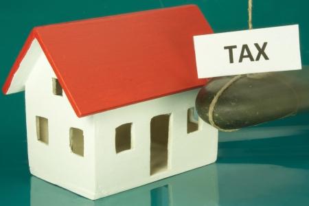 taxes like a boulder on the house