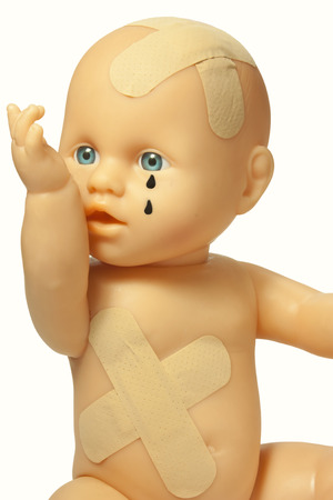 maltreatment: doll wounded symbol of cruelty to children