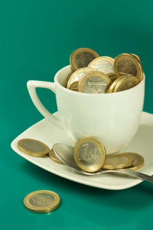 cup of coffee with coins of one euro Stock Photo