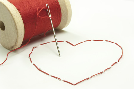 stitched heart with a red thread