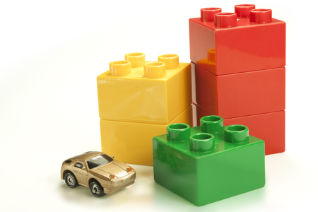 budget repair: colored bricks as a graph with cars Stock Photo