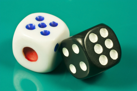 a pair of dice on green background