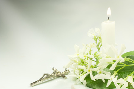 jasmine flowers crucifix and candle