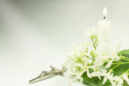 jasmine flowers crucifix and candle photo