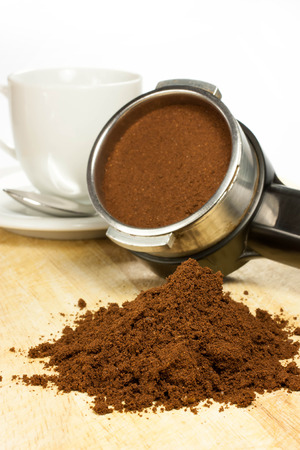 intense flavor: prepare an espresso coffee with ground coffee and coffee maker Stock Photo