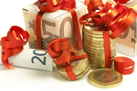 euro banknotes and coins wrapped as a gift photo