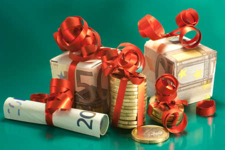 euro banknotes and coins wrapped as a gift