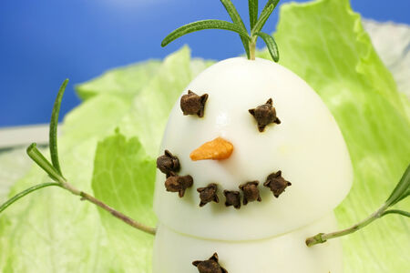 gastronomic: snowman gastronomic made with boiled eggs and clove