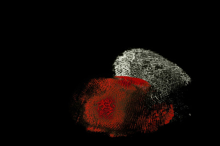 fingerprints white and red on black background
