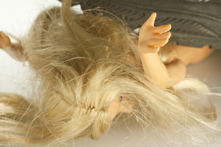 trampled: a doll as a victim of violence against women