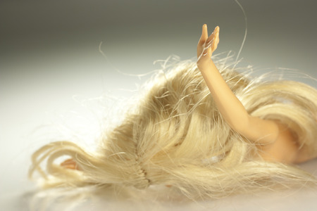 trample: a doll as a victim of violence against women