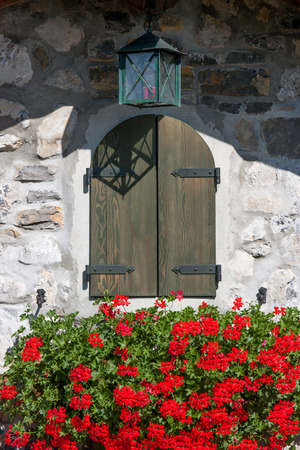 flourished: classic window mountain flourished with red geraniums