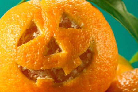 inlay: Mandarin inlay as a halloween pumpkin Stock Photo