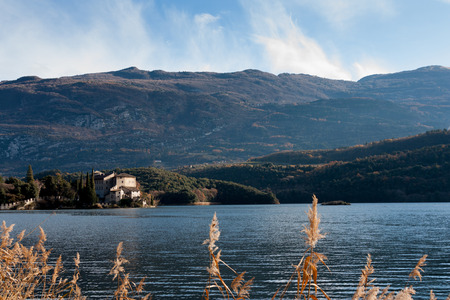 panoramic view of the lake with a castle and mountains Stock Photo