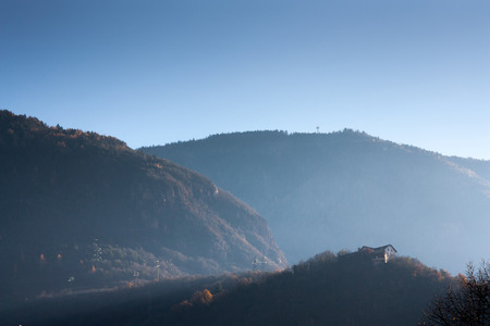 panoramic view of a home at first light of the sun with the haze