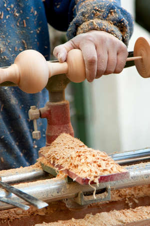 craftsman who works the wood on the lathe Stock Photo