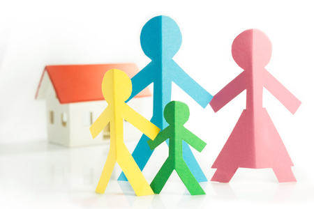 yellow paper: representation of the family with colorful paper figures Stock Photo