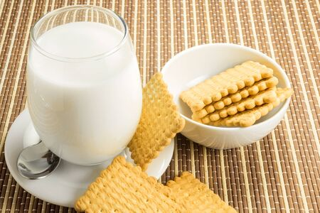 biscuits: glass of white milk with biscuits