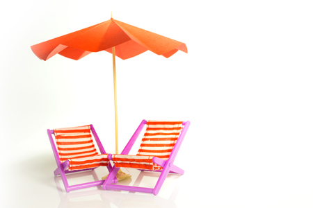 Red umbrella and chairs in rows in miniature