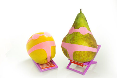 representation of women do not fit in a swimsuit like apple and pear Stock Photo
